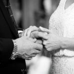 bride and groom lovingly holding hands