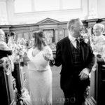 bride & groom walking down the aisle